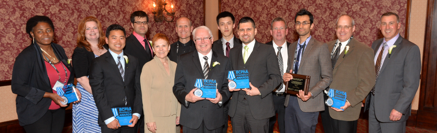Celebrating the 2014 BCPhA Pharmacy Award recipients: (from left to right) Joelle Mbamy, Stephanie Hahn (accepting on behalf of Adeline Tan), Jason Min, Chris Cameron, BCPhA CEO Geraldine Vance, Mike Dilfer, Ken Foreman, Dawei Ji, Omar Alasaly, Don Fraser, Aaron Sihota, Cam Bonell and BCPhA president Don Cocar.